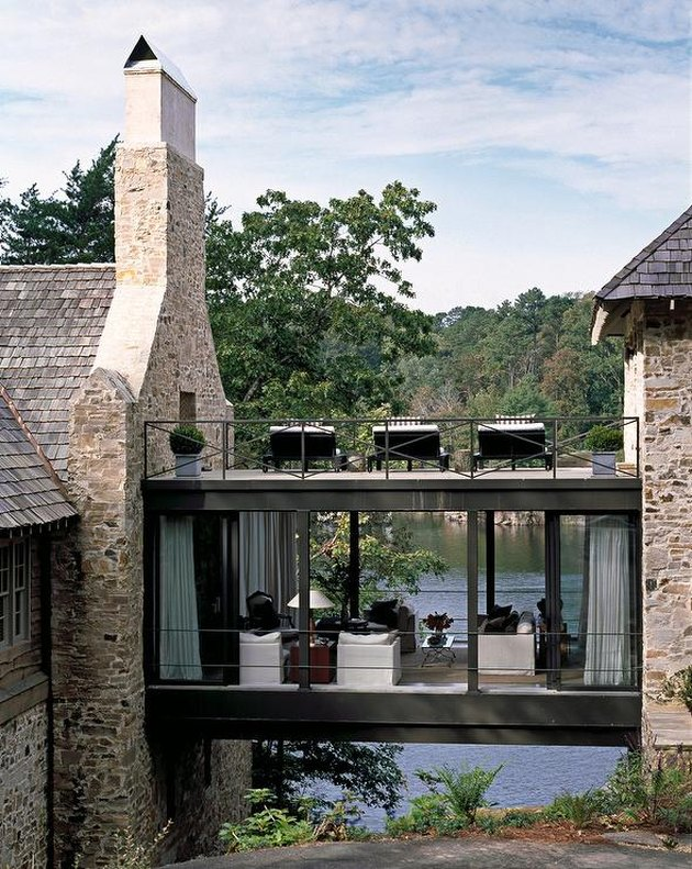 Stone Exterior Homes on Stone lake house with glass skyway by Andrew Brown Interiors