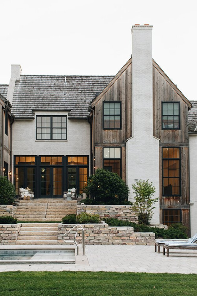 Stone Exterior Homes with Stone, wood and brick home by Kate Marker Interiors