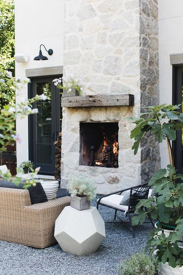 Stone Exterior Homes with Outdoor stone fireplace by Grand Tradition Homes