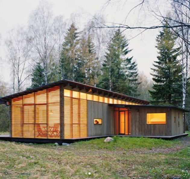 wood and glass cabin with addition of horizontal wood slats