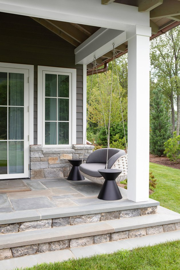 Stone Exterior Homes with Stone back patio by Chango & Co.