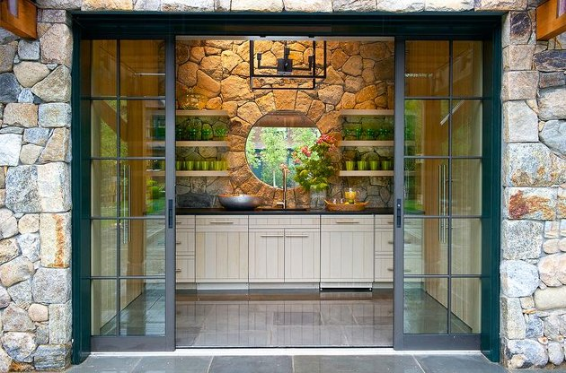 Stone Exterior Homes on Stone pool house kitchenette by Pimlico Interiors