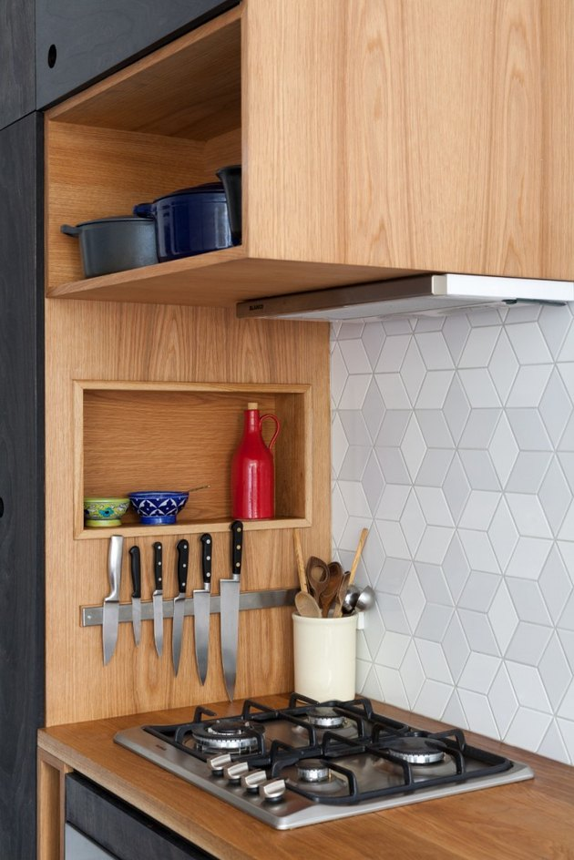 modern kitchen storage idea with clever storage above and to the side of the stove