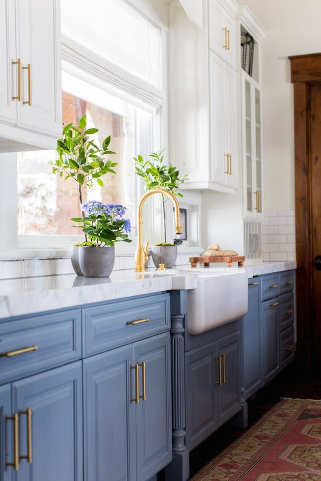 kitchen cabinet style with raised-panel door style in blue with brass hardware