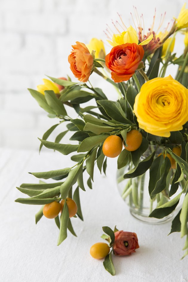 kumquat and ranunculus fall flower arrangements