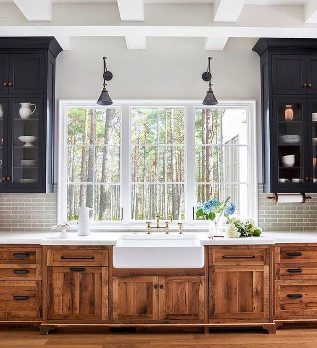 kitchen cabinet style with mission or craftsman style cabinets black on top and wood on bottom with farmhouse sink
