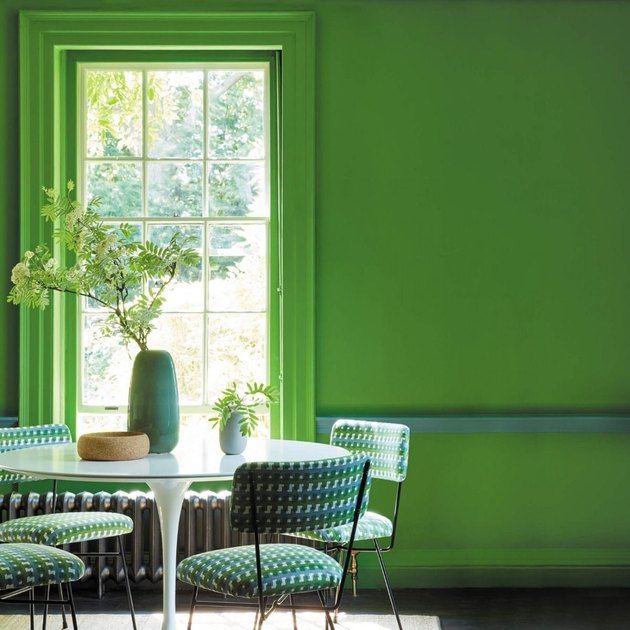 Yellow-green tertiary color walls in a traditional dining room