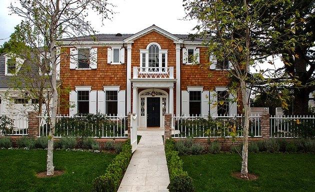 Colonial-style house with cedar shingle exterior siding ideas