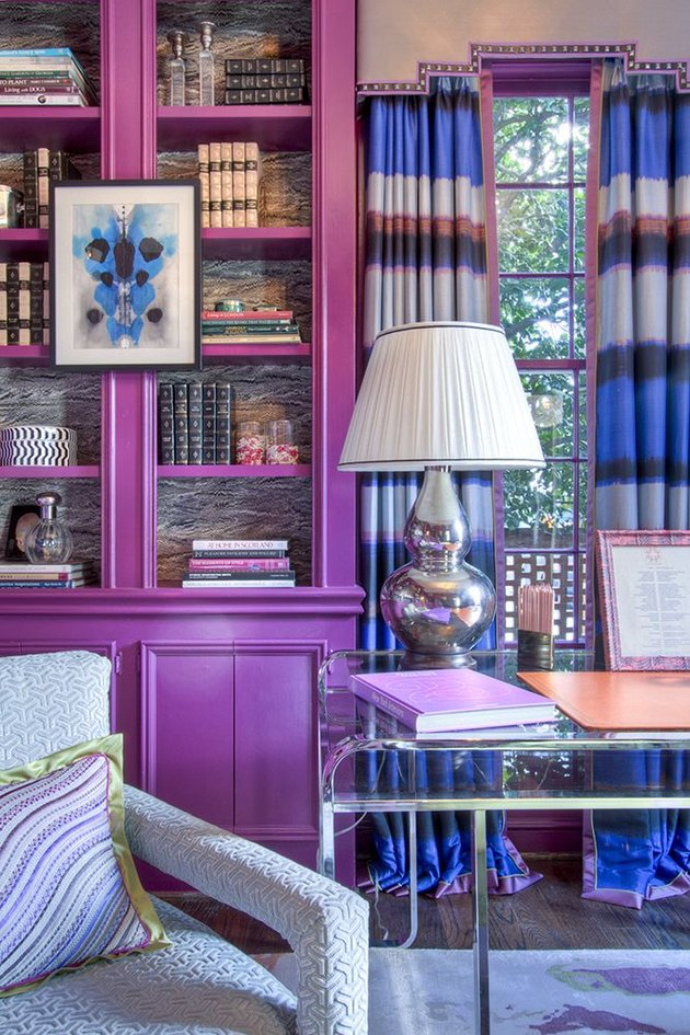 Red-violet tertiary color library with striped curtains and blue decor