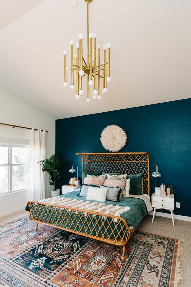 Blue-green tertiary color accent wall in a modern bohemian bedroom