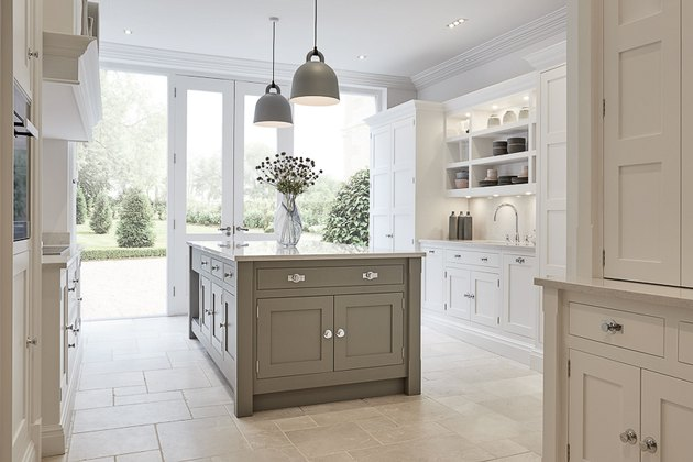 limestone kitchen flooring with white cabinets and gray island