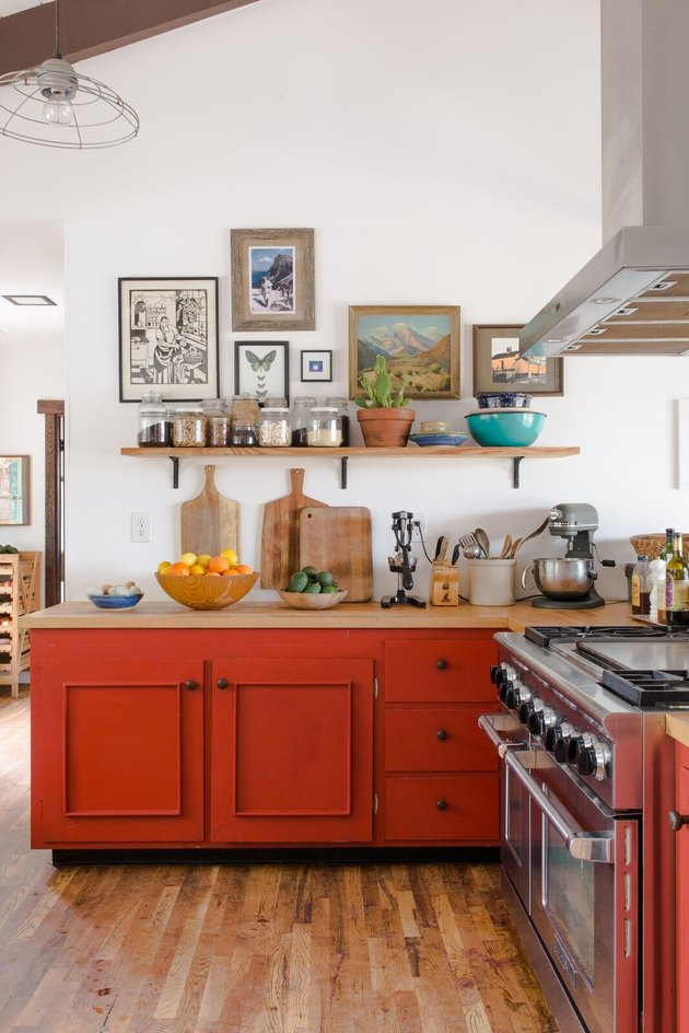 Red-orange tertiary color cabinets in a vintage-inspired kitchen