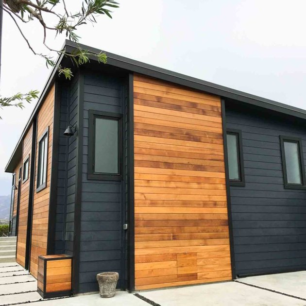 Black and wood finish exterior paneling on modular home
