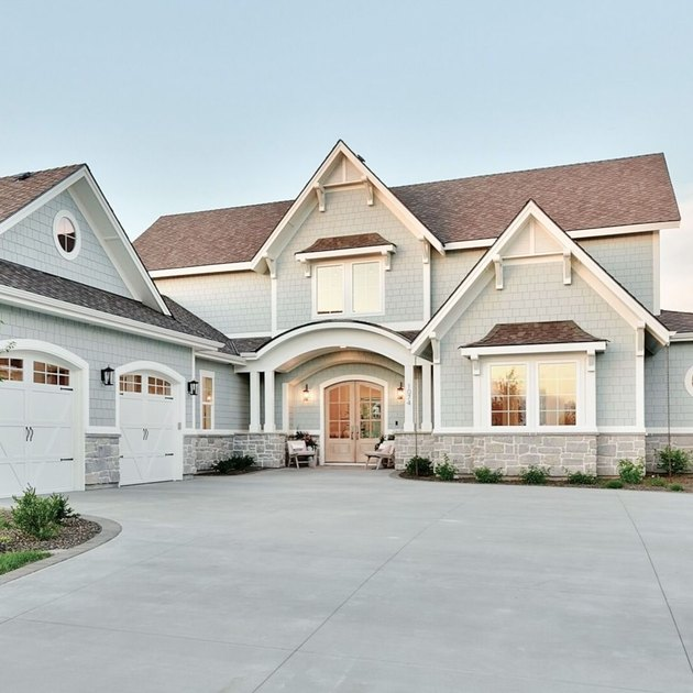 blue gray exterior paint with double doors and large driveway