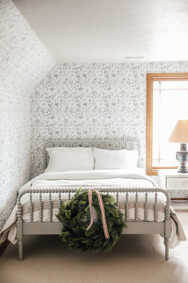 white finished attic idea for bedroom with whimsical wallpaper and bed