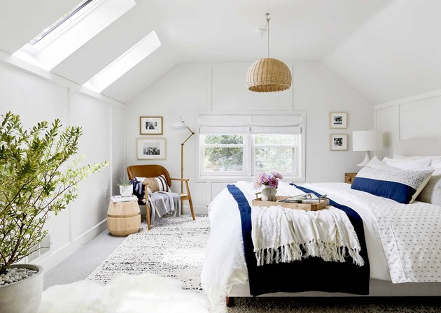 white bedroom finished attic idea with skylights and bed