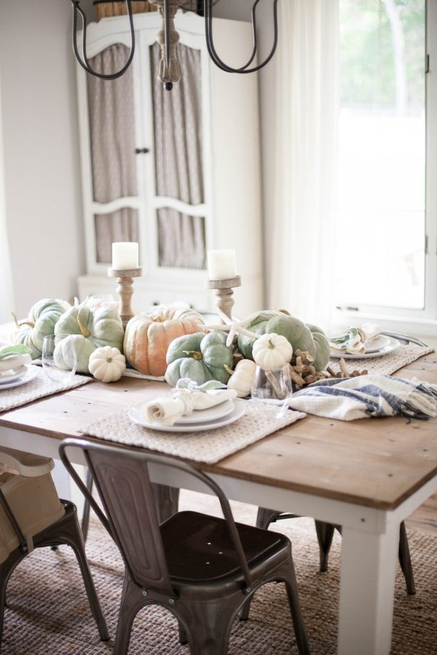 Coastal fall decor tablescape with pumpkins and starfish
