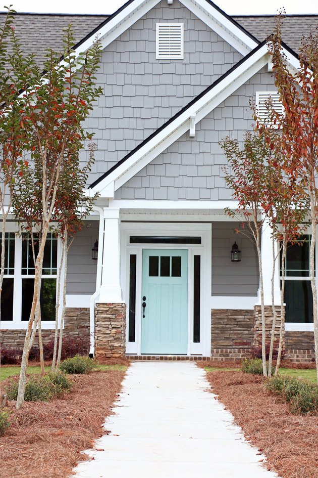 gray exterior paint with turquoise front door