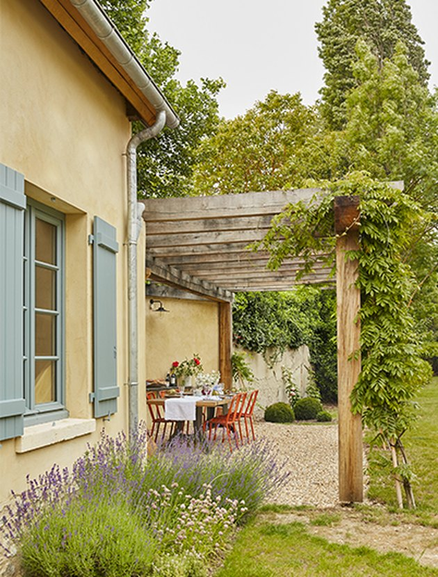 French country exterior with colorful shutters