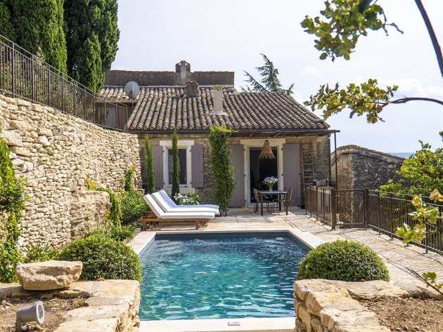 French country exterior with pool