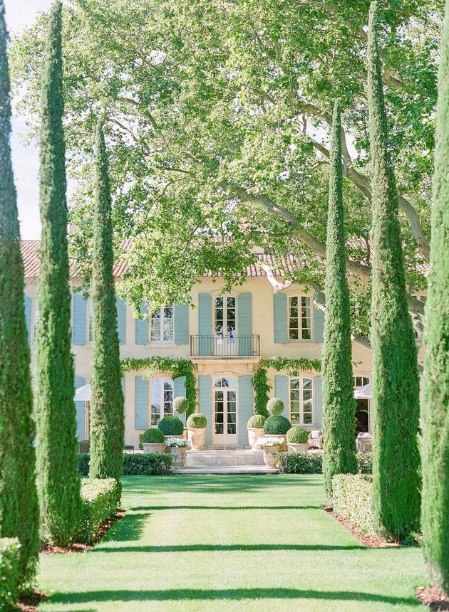 French country exterior with landscaping
