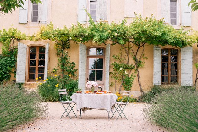 soft orange French country exterior with table set out front