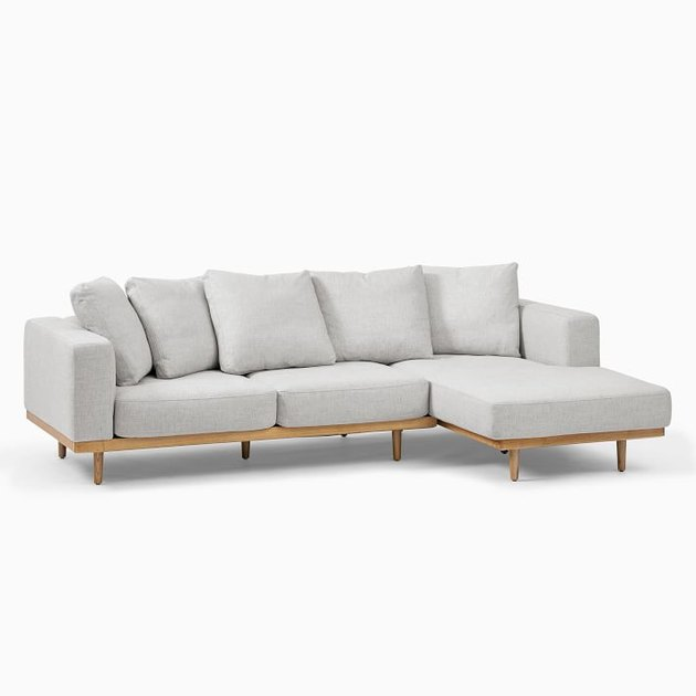 modern coastal sofa with wood base by West Elm