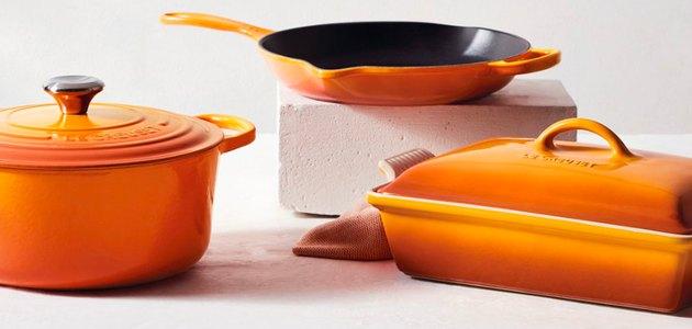 three kitchenware items in orange