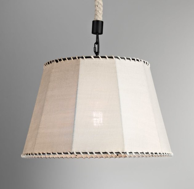 pendant light with burlap shade and whipstitching at the top and bottom