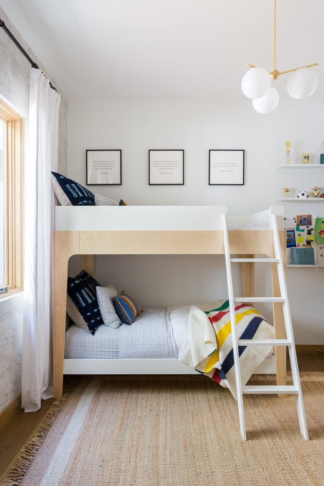 kids bedroom with bunkbeds and brass chandelier