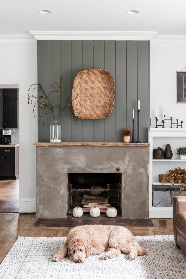 modern fall decor on fireplace mantel with basket hanging above