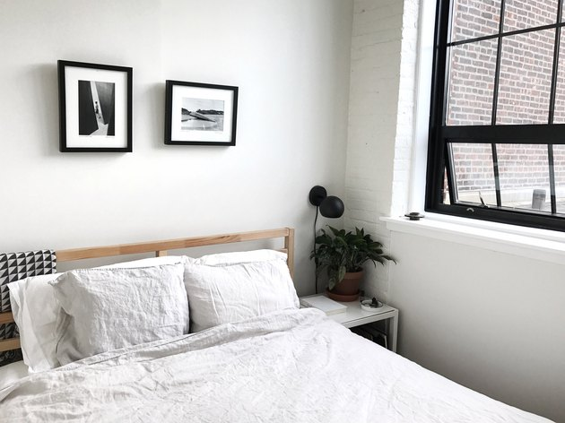 industrial bedroom with black steel frame windows