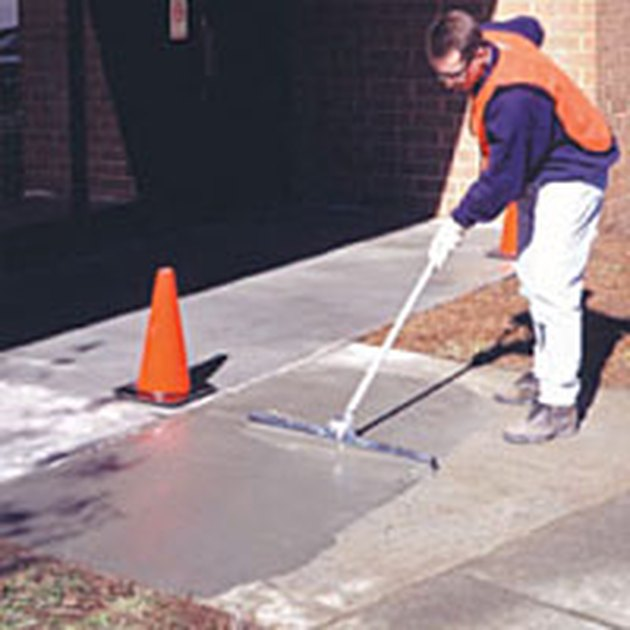 Applying concrete resurfacer.