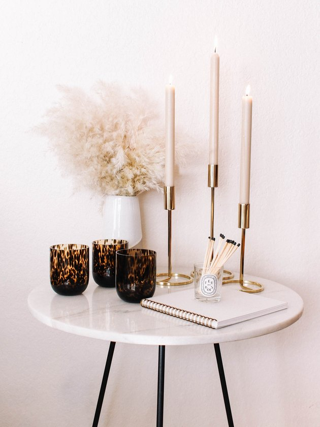 modern fall decor with white side table with candles and glasses