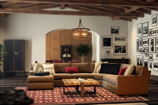 red-tinged living room with wood beam ceiling