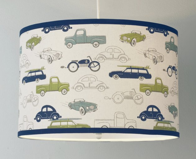 drum shaped pendant light with cars on the shade