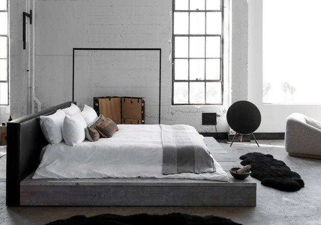 gray industrial bedroom with platform bed