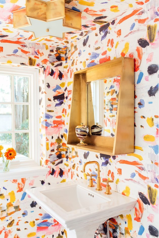 Powder room with colorful painted bathroom wallpaper and pedestal sink