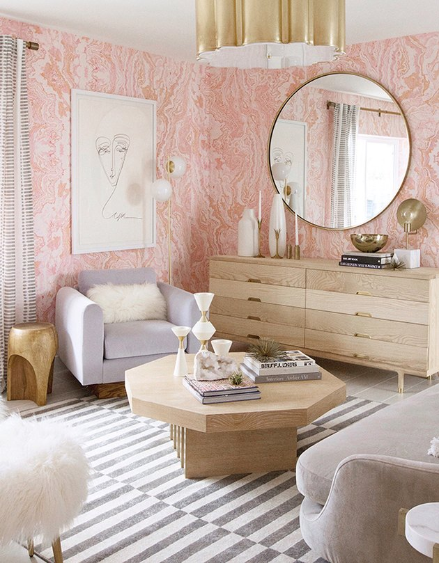 pink agate wallpaper with gold ceiling light and light wood furniture