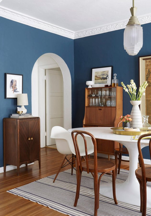 navy blue midcentury modern dining room
