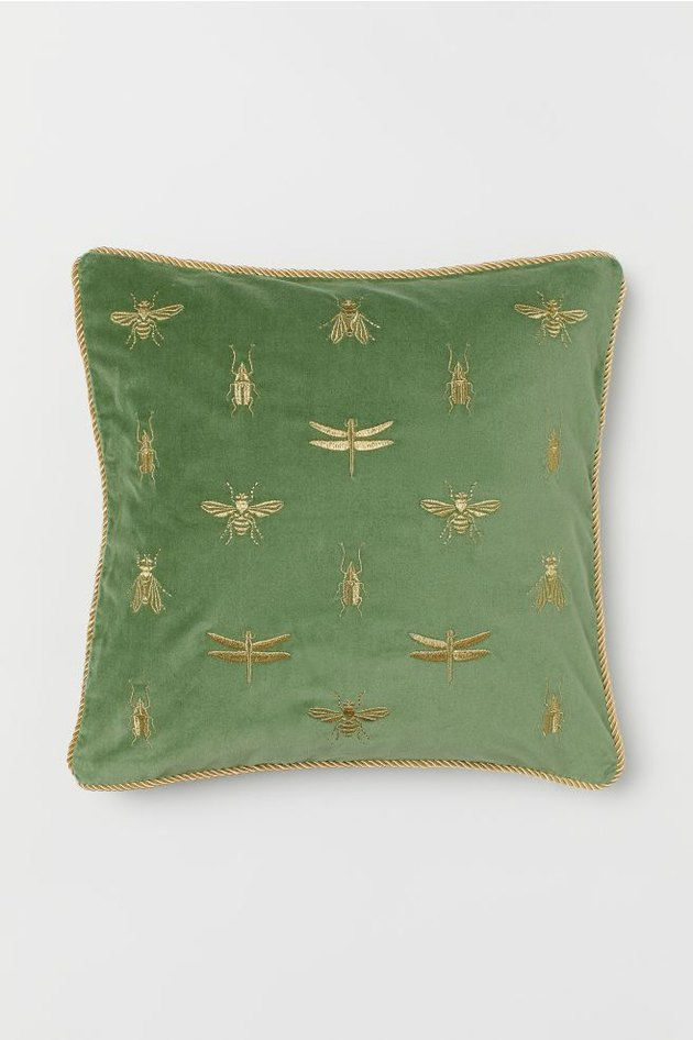 green velvet pillow with gold embroidered insects