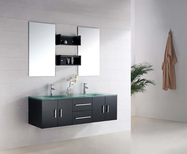 glass bathroom countertop on wall-mounted black vanity cabinet