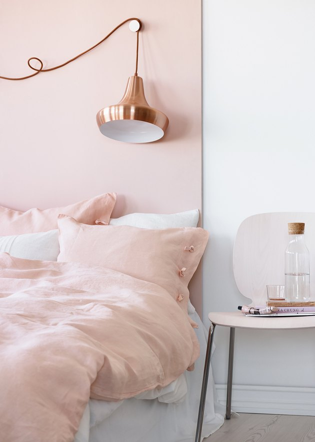pink bedroom with copper lighting