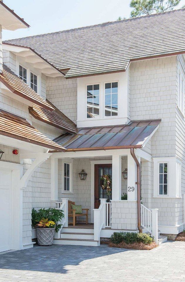light gray exterior paint with shingle house and metal roof
