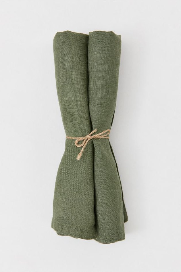 green linen napkins tied with twine