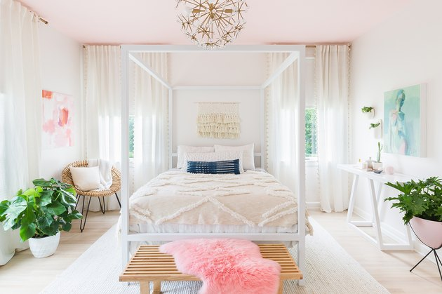 pink bedroom with white walls and blush ceiling and four-poster bed
