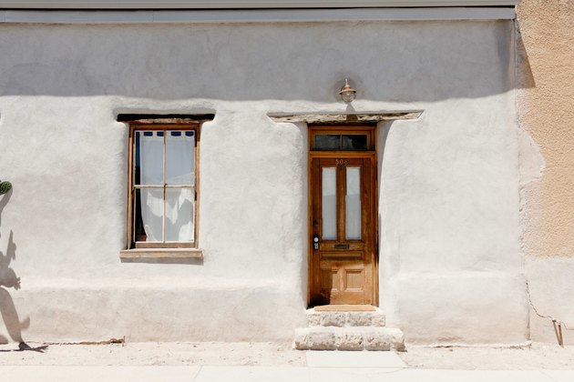 The front door of the adobe rowhouse.
