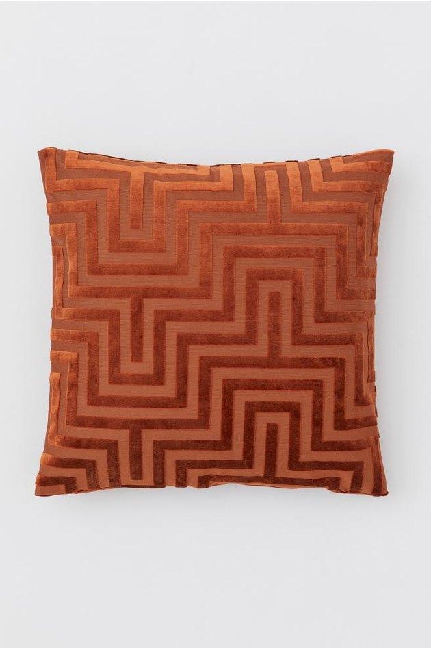 rust colored geometric pillow