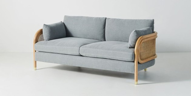 coastal sofa by Anthropologie with two seats and caned back