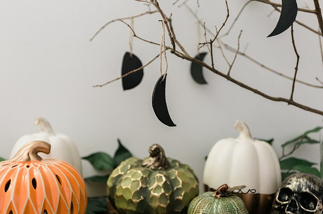 Loop the moon phases ornaments over the branches to complete the look.